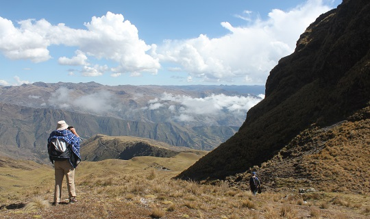 David Hoffman gazning down across cloudy Andean slopes